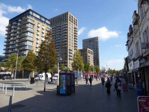 Royal Arsenal Riverside: imposing frontage to Plumstead Rd with bus stops adjacent